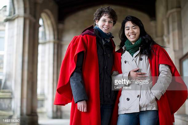University students in traditional capes