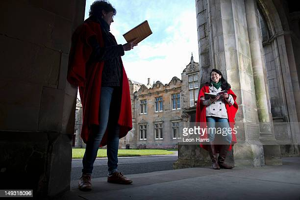 university students in traditional capes - st. andrews scotland stock pictures, royalty-free photos & images