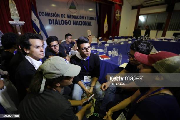 University students' leader Lesther Aleman meets in private with members of the April 19 movement during the socalled national dialogue talks among...