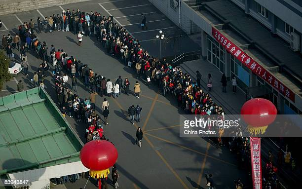 University students line up to enter a job fair of nationwide meteorological departments for graduating students on December 7 2008 in Beijing China...
