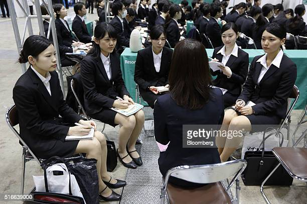 University students listen to a company recruiter at a job fair hosted by Mynavi Corp in Tokyo Japan on Sunday March 20 2016 The Bank of Japan said...