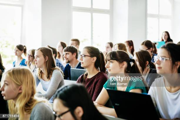 university students listening and concentrating during lecture - university stock pictures, royalty-free photos & images