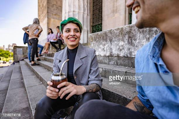 university students on stairs - green hair stock pictures, royalty-free photos & images