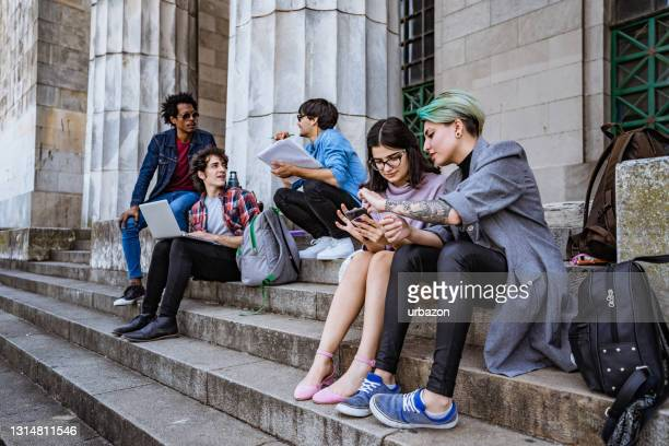 university students on stairs - campus stock pictures, royalty-free photos & images