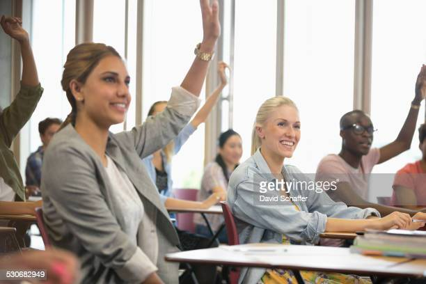 University students raising hands during seminar