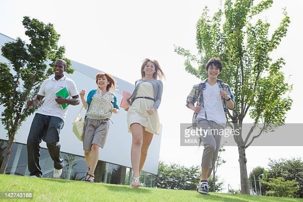 University students running on lawn