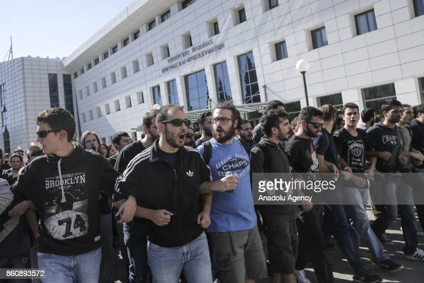 University students shout slogans as they match towards Greek Ministry of National Education building to protest some regulations at universities in...