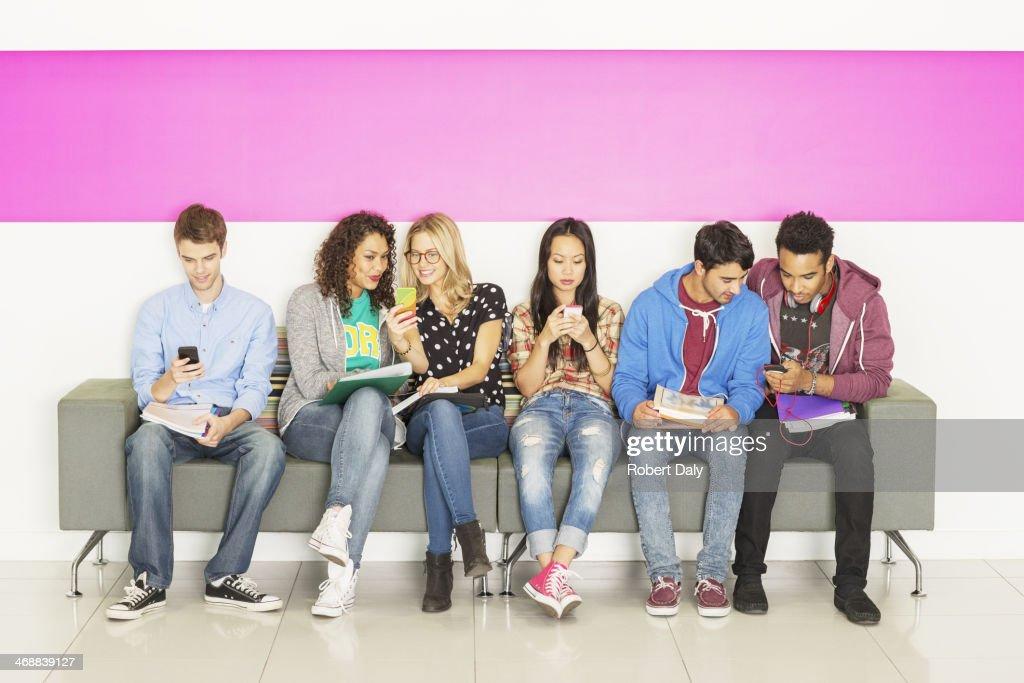 University students sitting on bench : Stock Photo