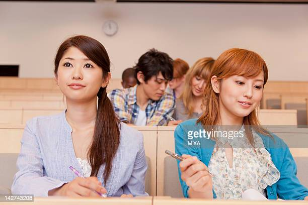 University students studying in lecture theater