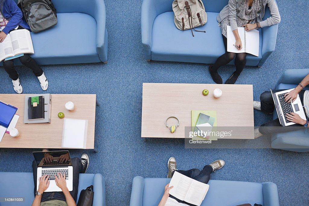 University students studying in lounge : Stock Photo