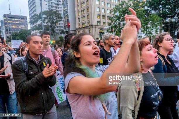 University students take part in a protest against the education policies of Brazilian President Jair Bolsonaro's government in Sao Paulo Brazil May...