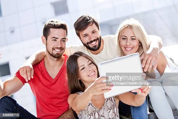 University students taking a self portrait