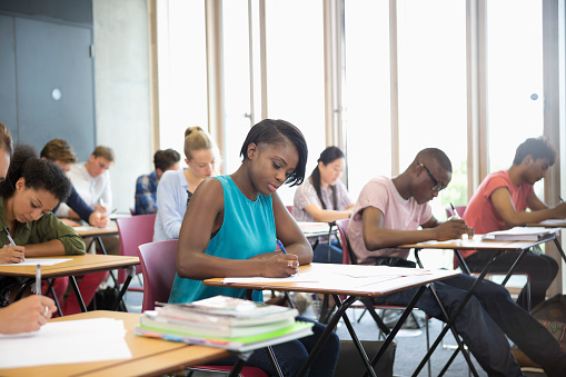 University students taking exam at classroom - gettyimageskorea