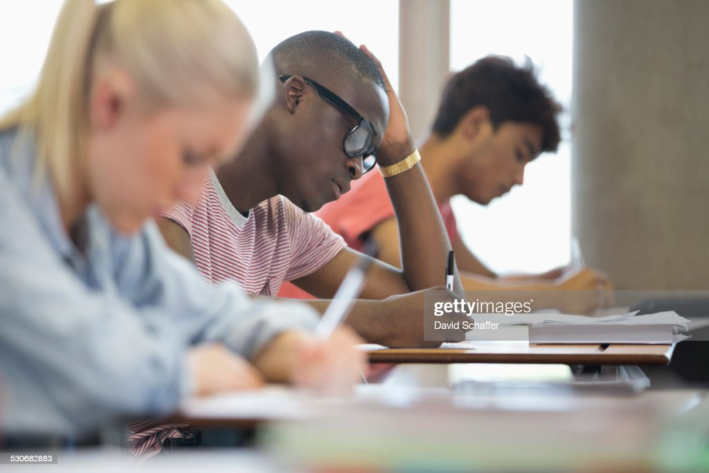 University students taking exam : Stock Photo