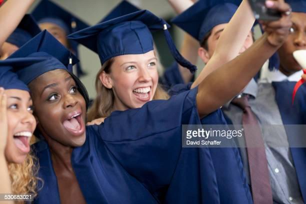 University students taking selfie after graduating