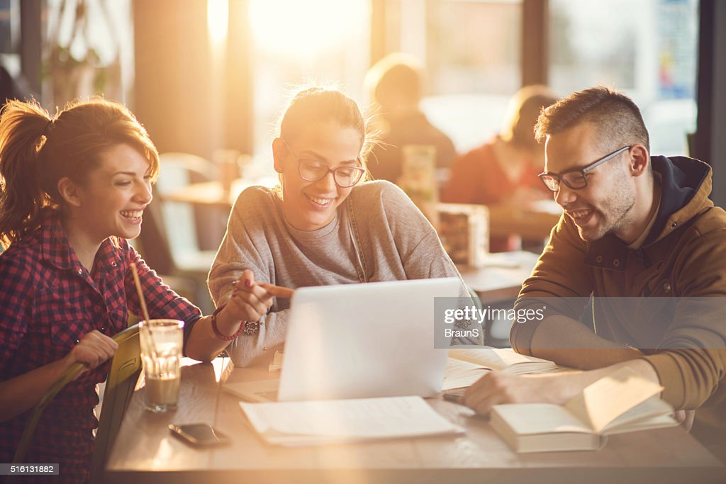 University students using computer for their research in a cafe. : Stock Photo