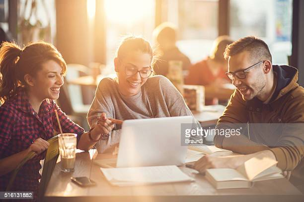 university students using computer for their research in a cafe. - person in education stock pictures, royalty-free photos & images