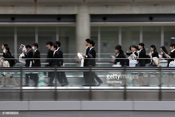 University students walk through a job fair hosted by Mynavi Corp. In Tokyo, Japan, on Sunday, March 20, 2016. The Bank of Japan said there has been...