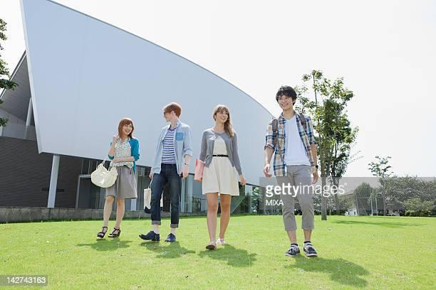 University students walking on lawn
