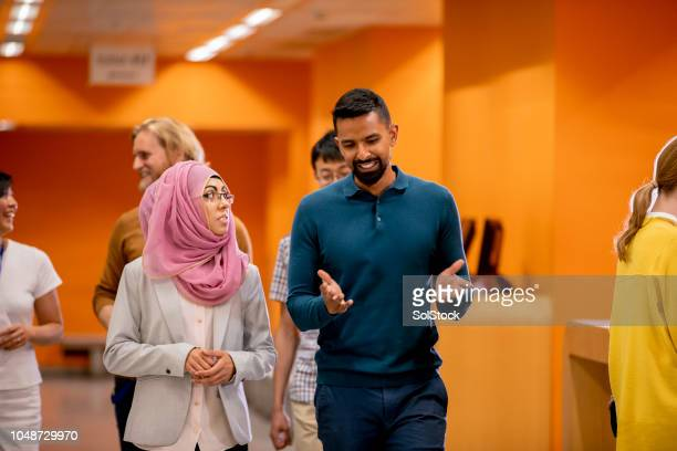 university students walking to class - multiracial group stock photos and pictures