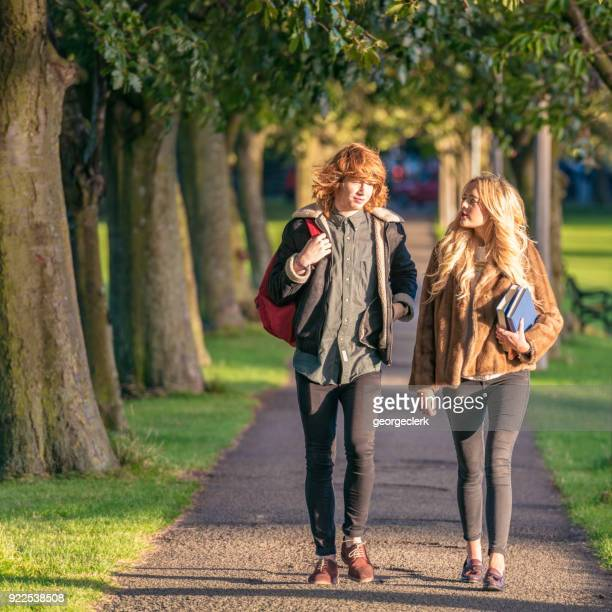 university students walking together - edinburgh scotland stock photos and pictures