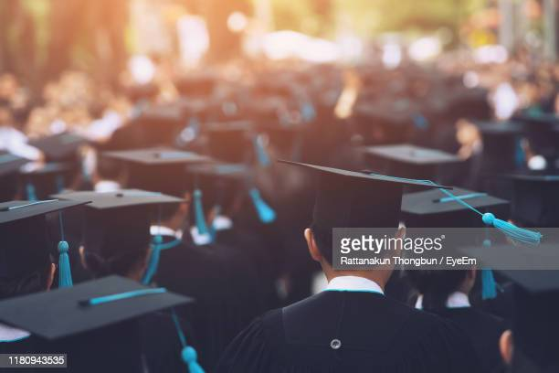 university students wearing mortarboard during event - graduation stock pictures, royalty-free photos & images