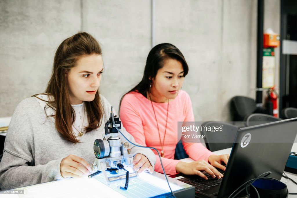 University Students Working With Complex Equipment During Experiment : Stock Photo