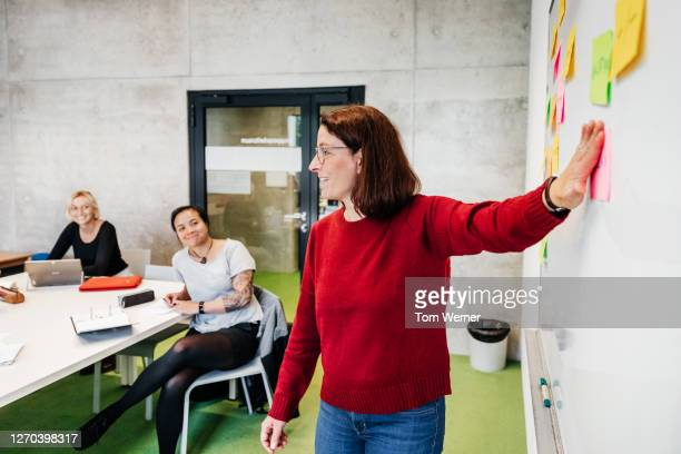 university tutor giving presentation during seminar - education stock pictures, royalty-free photos & images