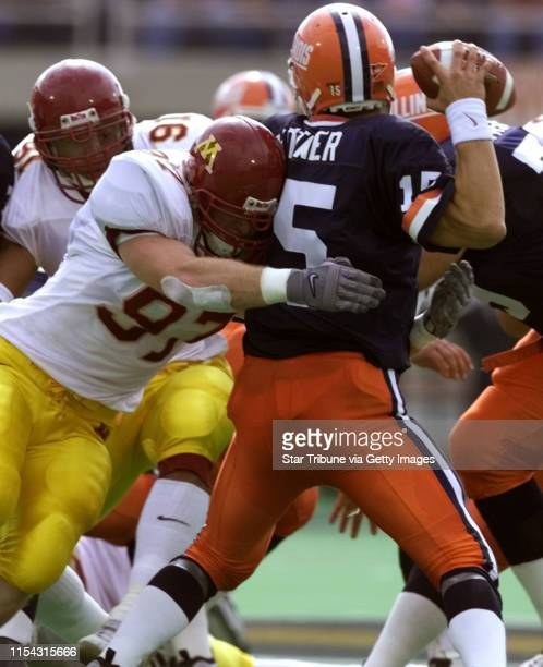 Universtiy of Minnesota defensive lineman Ben Mezera sacks University of Illinois quarterback Kurt Kittner during the game at Illinois Karon Riley of...