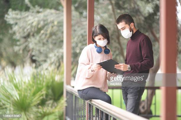universty students with mask are at campus. - college admission stock pictures, royalty-free photos & images