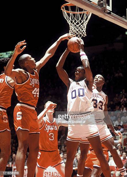 Univesity of Connecticut center Cliff Robinson rebounds the ball against Syracuse University forward Derrick Coleman during a Big East game in...