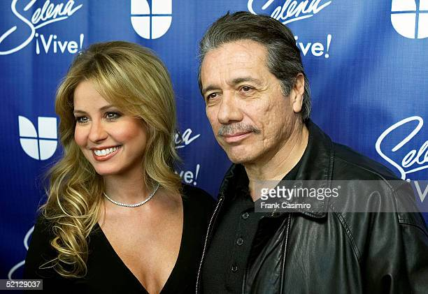 Univision personality Myrka Dellanos and actor Edward James Olmos pose for photographers at the Selena Vive press conference February 3 2005 in...