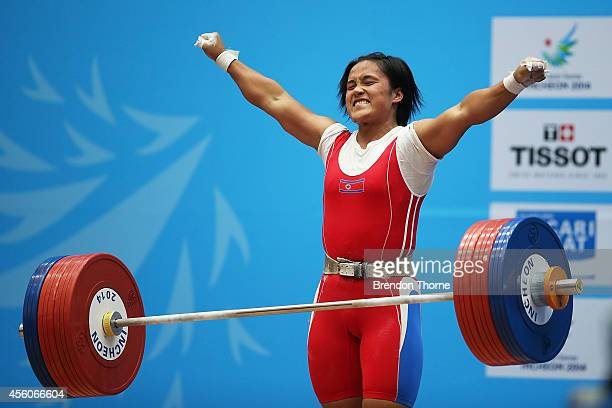 Unju Kim of North Korea celebrates after claiming the Gold medal and breaking the world record of the clean and jerk in the Women's 75kg...