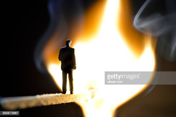 GER Unkel a model figure on a burning match as a symbol of the burnout syndrome