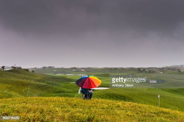 Unknow fan stand protect from the rain under an umbrella during the day 3 of the HNA French Open on July 1 2017 in SaintQuentinenYvelines France
