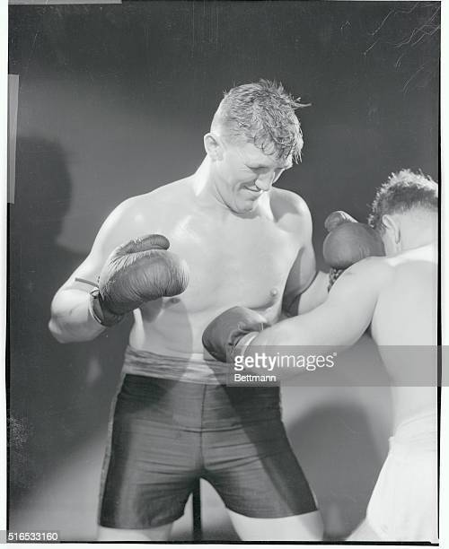 Unknown boxer taking a punch to the stomach