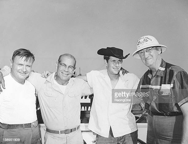 "Eddie Skinner Ted Chamberlain Neil Castles and Erwin ""Cannonball"" Baker take a moment at a NASCAR race in the late 1950s"