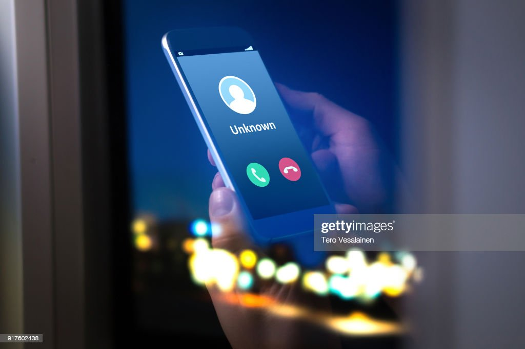 Unknown number calling in the middle of the night. Phone call from stranger. : Stock Photo