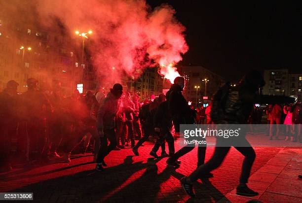Unknown people looking like a football ultras throw stones flares and firecrackers towards the police holding the cordon around concert hall Unknown...