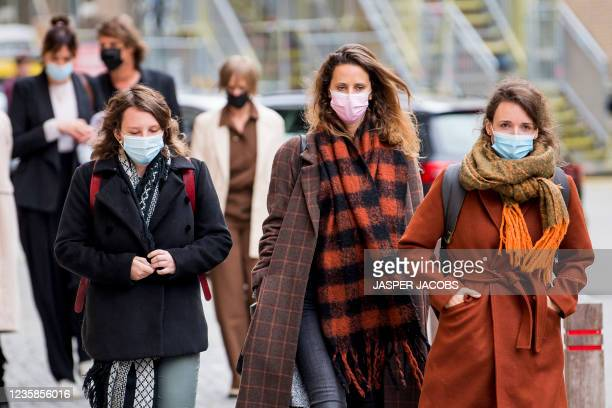 Unknown people pictured leaving after a session of the Criminal Court in Mechelen in the trial of television producer Bart De Pauw, accused of...