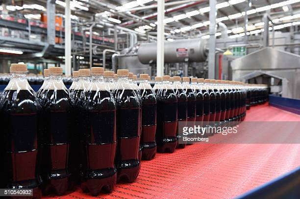 Unlabeled bottles of CaffeineFree Diet CocaCola move along a conveyor at a CocaCola Amatil Ltd production facility in Melbourne Australia on Tuesday...