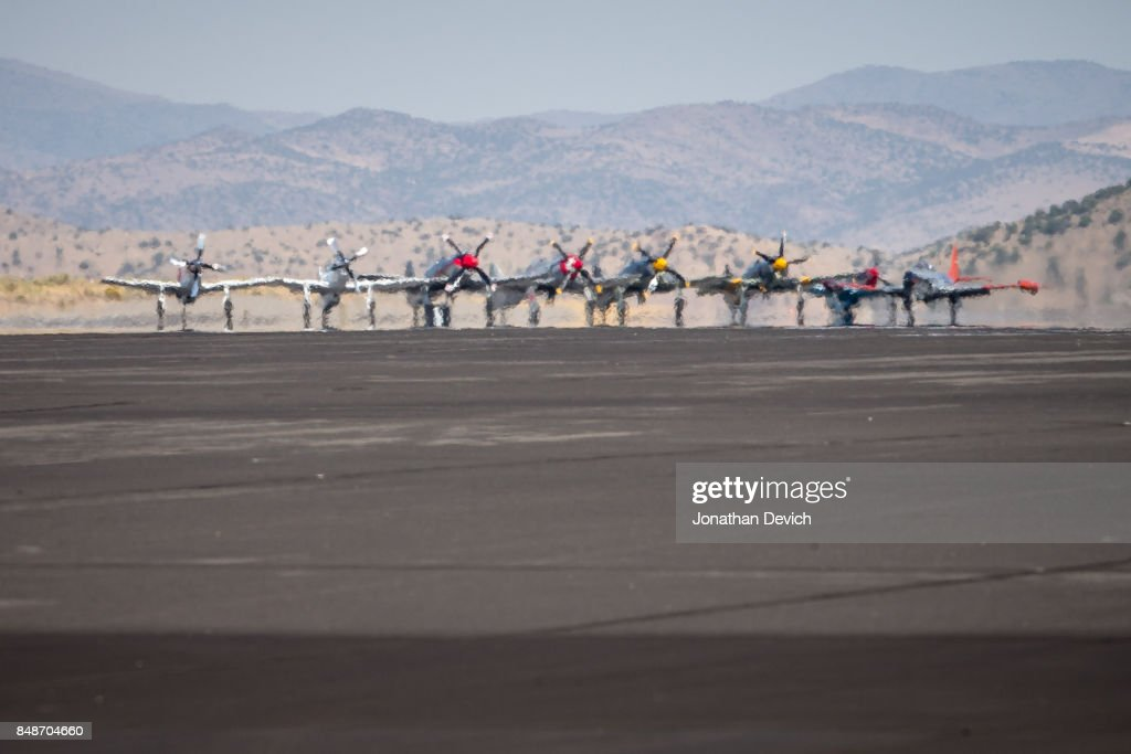 Unlimited class airplanes wait at the end of the runway before beginning their race at the Reno Championship Air Races on September 17, 2017 in Reno, Nevada.