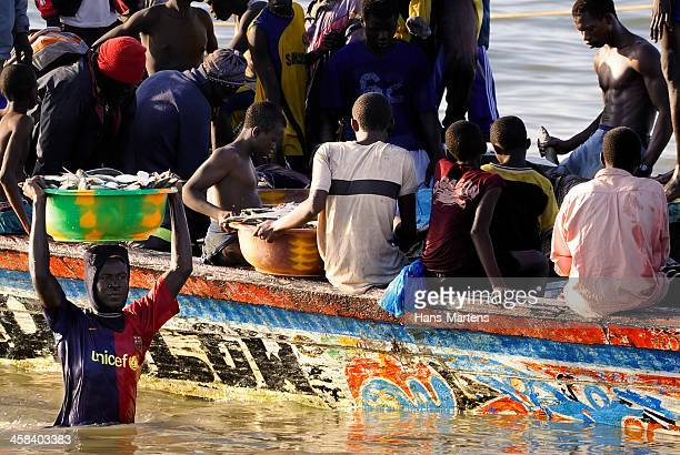 Unloading a fishing boat in Gambia, Africa