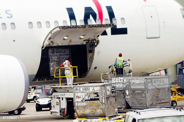 unloading air cargo - cargo airplane stock photos and pictures
