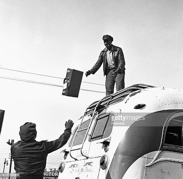 Unloading baggage from the roof of a Greyhound Bus Chattanooga Tennessee September 1943