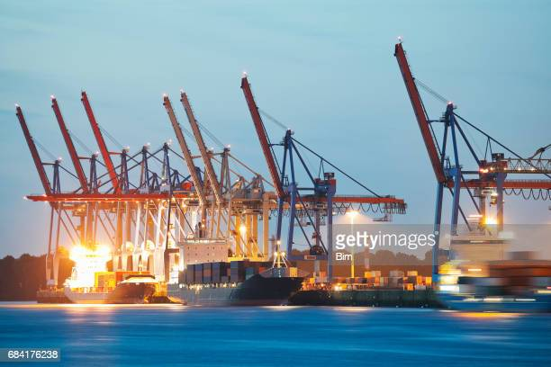 Unloading Container Ships at Dusk, Hamburg Harbor, Germany
