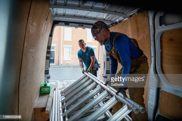unloading the van - vehicle interior stock pictures, royalty-free photos & images