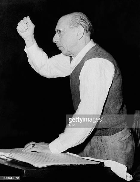 Unlocated and undated picture of Russianborn US composer Igor Stravinsky conducting an orchestra