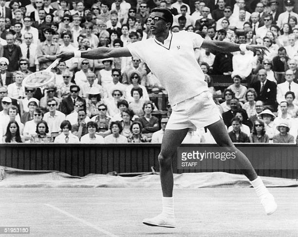 Unlocated picture taken in the 1968s of American famous tennis player Arthur Ashe who return the ball to his opponent as he was the first...