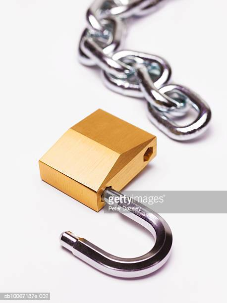 Unlocked padlock and chain, close-up